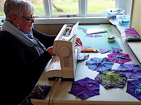 Quilter working on her one block wonder blocks